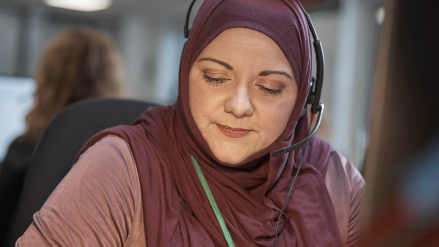 Childline counsellor listening to a telephone call