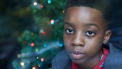 Young boy alone at Christmas