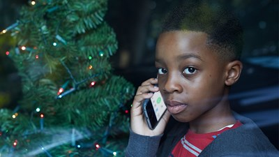Young boy on phone at Christmas
