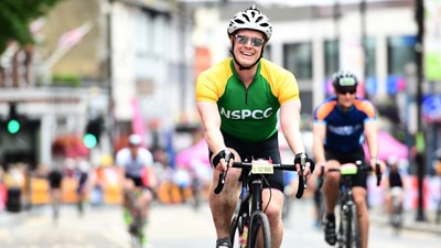 Man on bike wearing an NSPCC cycling jersey